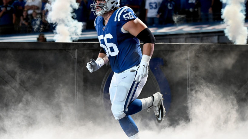 Colts OL-Quenton Nelson runs out of the tunnel.