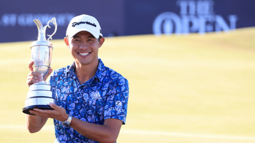 Collin Morikawa poses after his Open Championship win on the 18th green