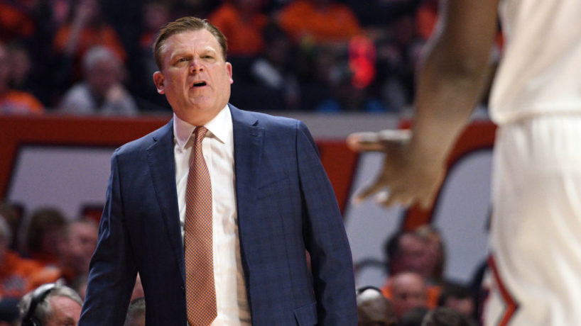 Brad Underwood coaches from the sidelines and speaks to his team in a game for Illinois