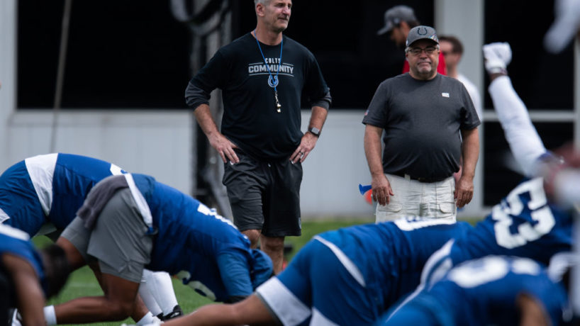 Frank Reich talks with his team before practice.
