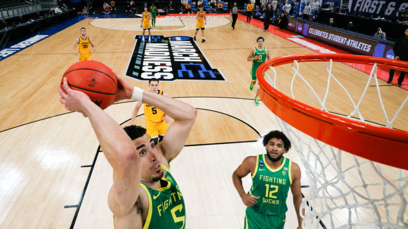 During March Madness, Chris Duarte goes up and slams a dunk with his Oregon teammates and opponents watch from behind