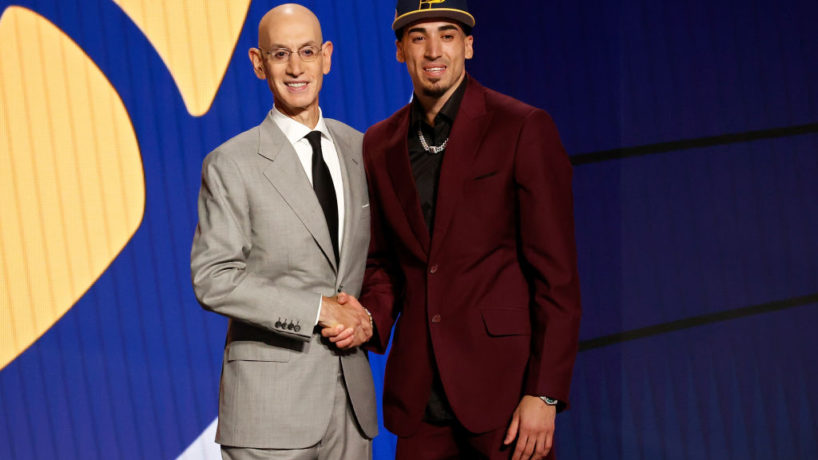Chris Duarte looks onward and shakes the hand of NBA Commish Adam Silver moments after being drafted by the Indiana Pacers