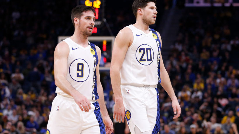 T.J. McConnell and Doug McDermott walk off the floor after a game.