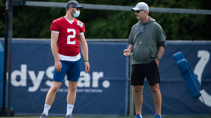 Carson Wentz chats with Frank Reich before practice.