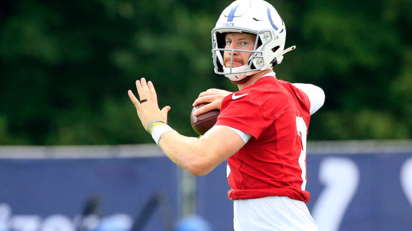 Carson Wentz looks onward preparing to throw at Indianapolis Colts training camp