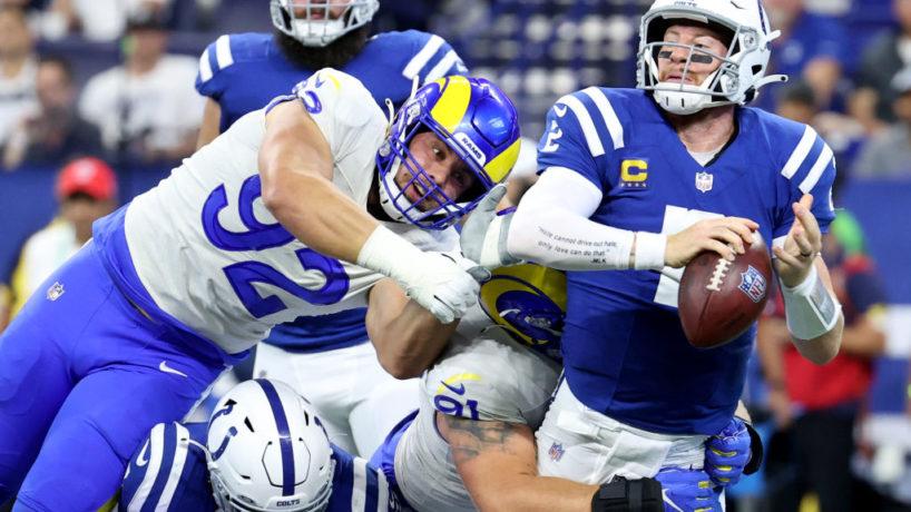 Colts QB-Carson Wentz tries to avoid a sack.