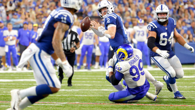 Colts QB-Carson Wentz goes down when attempting a pass.