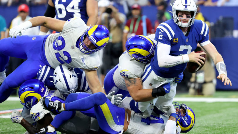 INDIANAPOLIS, INDIANA - SEPTEMBER 19: Safety Taylor Rapp #24 and defensive tackle Greg Gaines #91 of the Los Angeles Rams tackle quarterback Carson Wentz #2 of the Indianapolis Colts in the first half of the game at Lucas Oil Stadium on September 19, 2021 in Indianapolis, Indiana. (Photo by Andy Lyons/Getty Images)