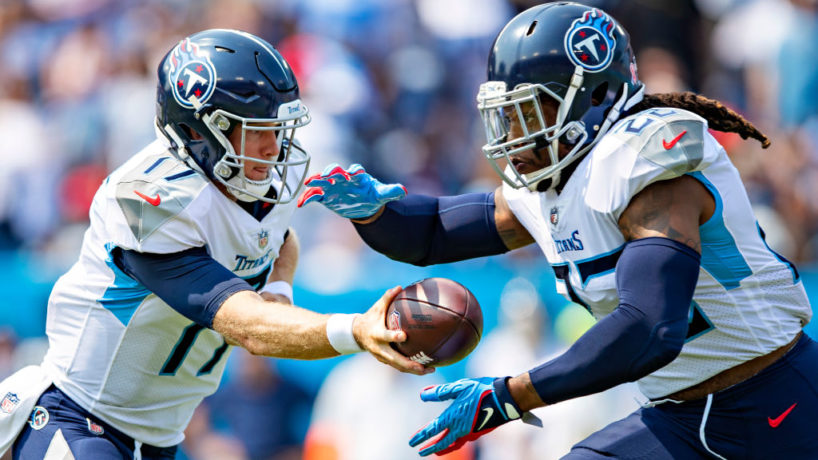 NASHVILLE, TENNESSEE - SEPTEMBER 12: Ryan Tannehill #17 makes a hand off to Derrick Henry #22 of the Tennessee Titans during the game against the Arizona Cardinals at Nissan Stadium on September 12, 2021 in Nashville, Tennessee. The Cardinals defeated the Titans 38-13. (Photo by Wesley Hitt/Getty Images)