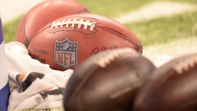 NFL footballs laying on field