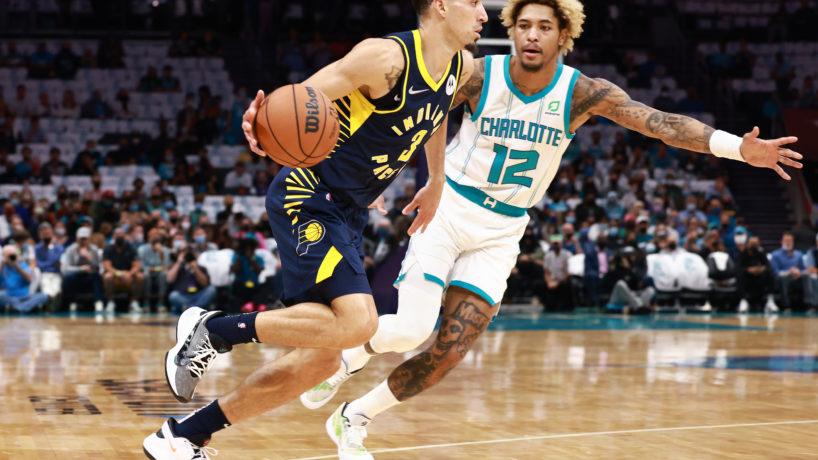 Chris Duarte dribbling ball around Hornets defender