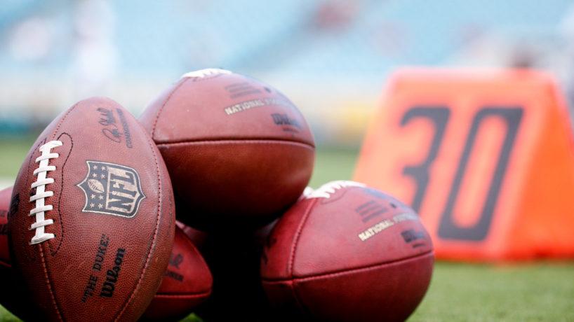 Pile of NFL footballs