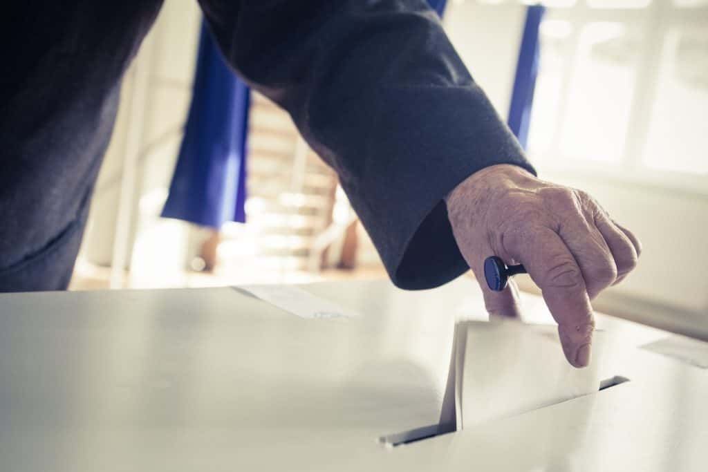ballot being put into a ballot box