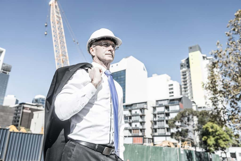 Man in suit and hard hat