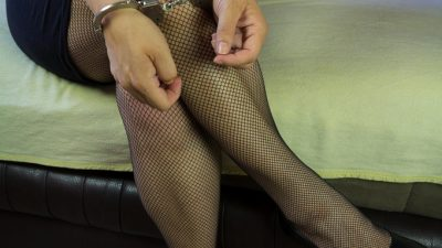 Woman in cuffs