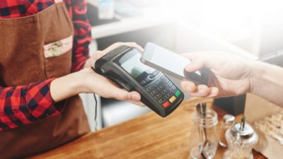 Person paying for transaction with smart phone