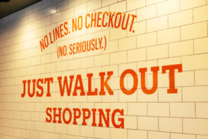 "Amazon Go sign that reads ""No Lines. No Checkout. (No seriously) Just Walk Out Shopping"""