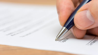 hand signing a document