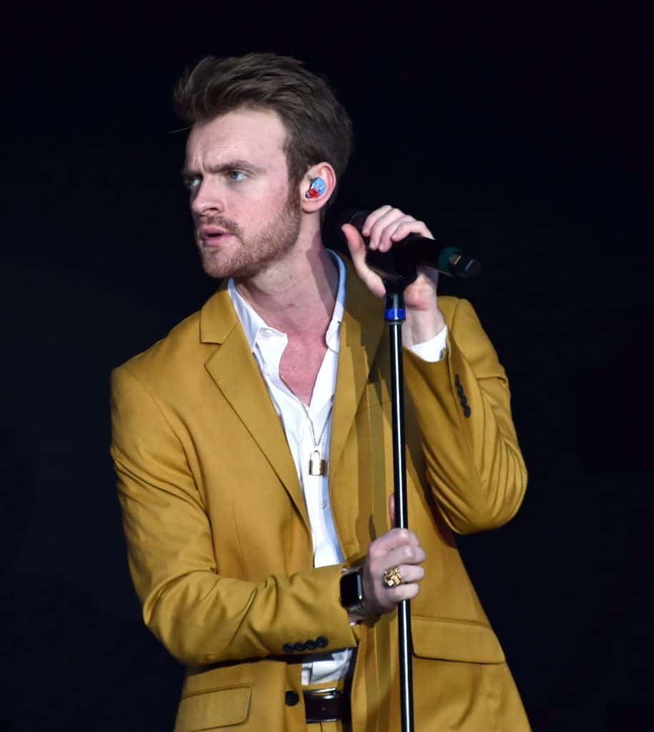 Finneas performing on stage