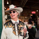 KGSR: Man posing with Ziegenbock beer