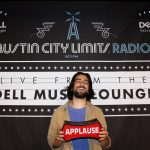 Dell Music Lounge with Noah Kahan: Noah Kahan holding applause sign
