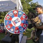 Blues on the Green July 17th, 2019: Man and dog spinning the Fox 7 wheel