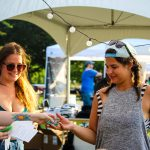 Blues on the Green May 22nd, 2019: guests grabbing blues on the green patch