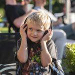 kid listening to music on headphones