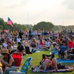 Blues on the Green May 22nd, 2019: people sitting on the grass