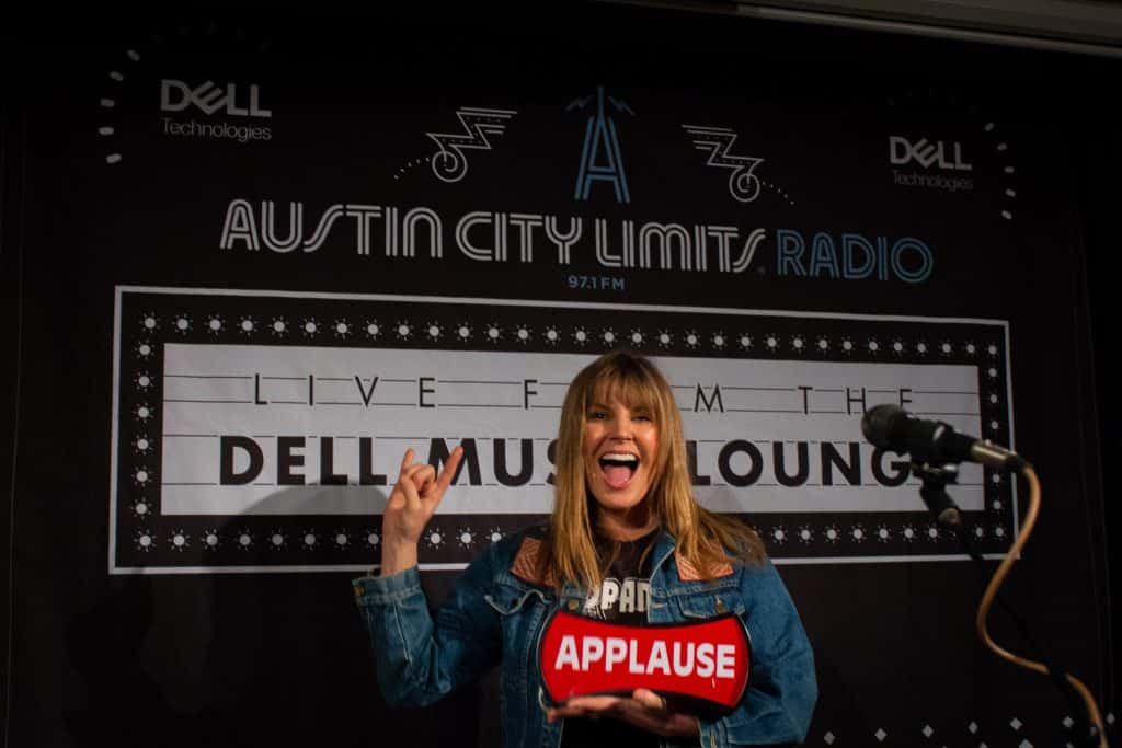 Grace Potter holding on-air sign