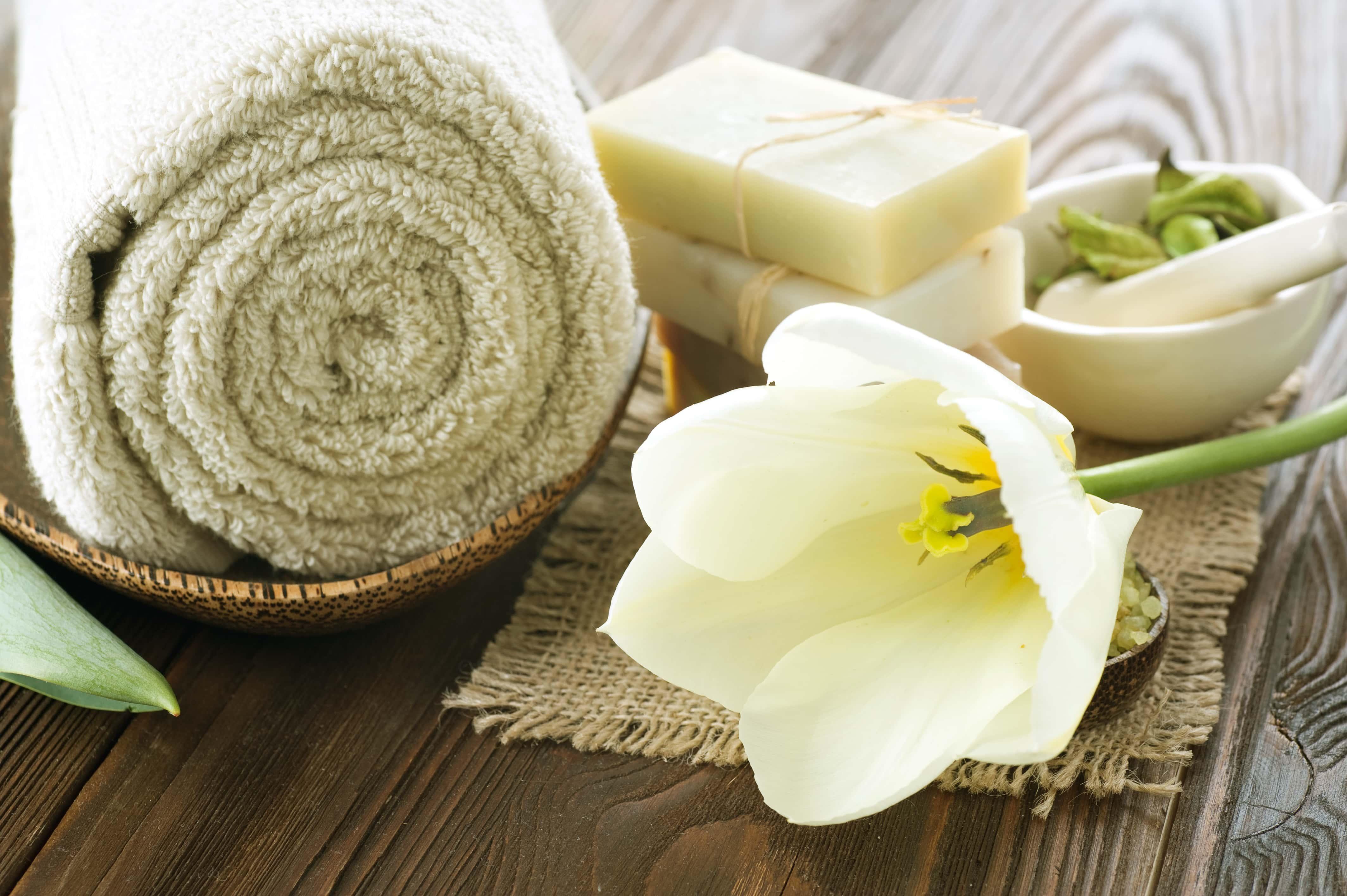 bath towel, soap, flower