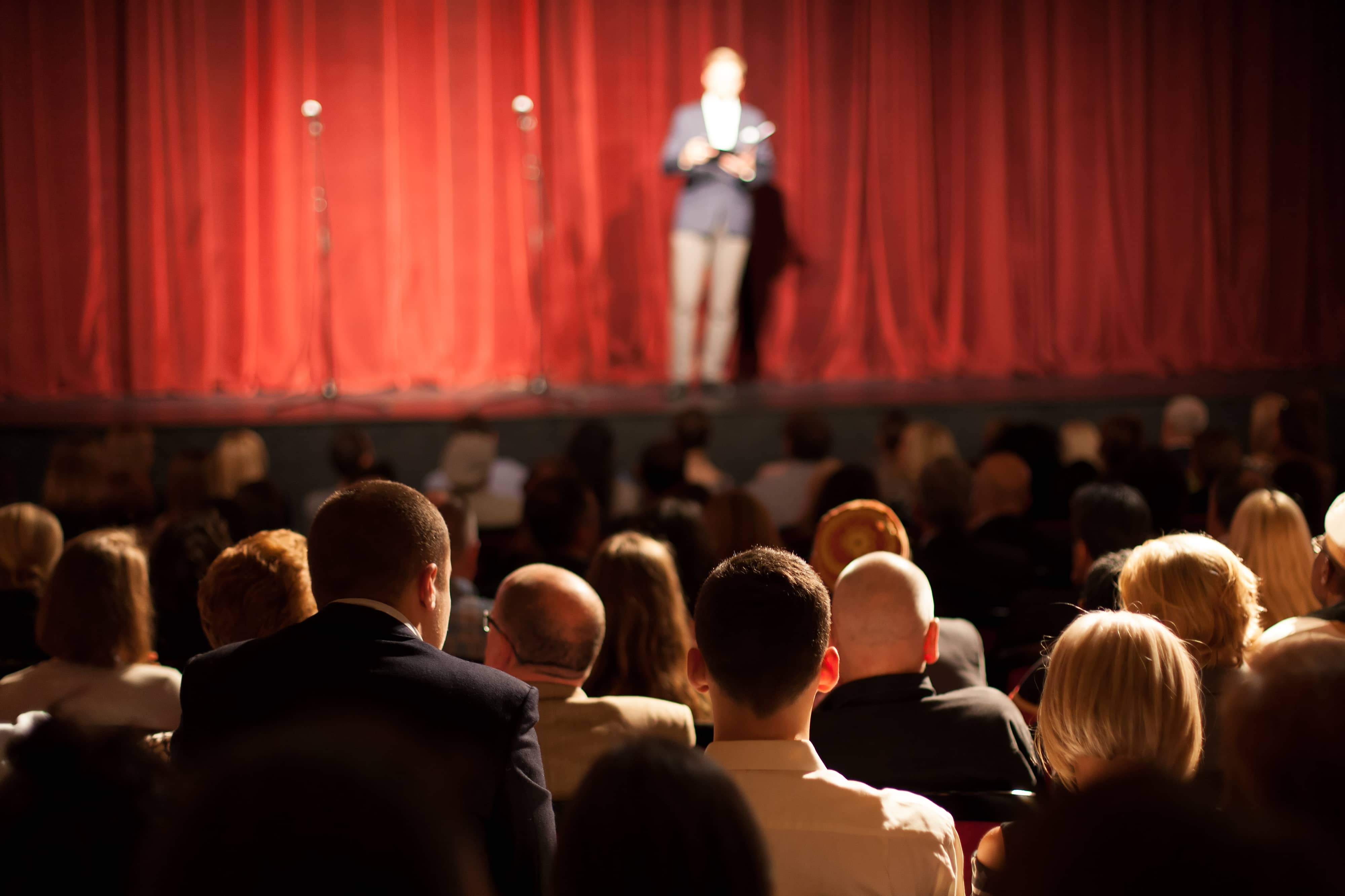 Stand up comedian on stage.