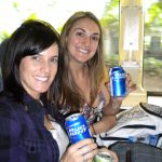 #TBT Bud Light Party Cruise : Deb and former 'Sorority Intern' Cassandra at the Bahamas Bud Light Party Cruise from 2009 holding two cans of Bud Light.