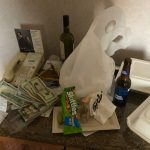 Jason's Vegas Vacation: a bunch of money, booze bottles, and old food containers left on Jason's hotel nightstand