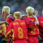 Team Romania: 1998 World Cup: Team Romania 1998 in World Cup with all blonde hair playing in group huddle