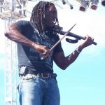 #TBT Bud Light Party Cruise : A violinist at the Bahamas Bud Light Party Cruise from 2009.