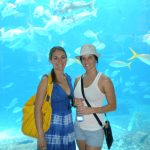 #TBT Bud Light Party Cruise : Deb and former 'Sorority Intern' Cassandra at the Bahamas Bud Light Party Cruise from 2009 in front of fishes in an aquarium.