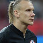 Domagoj Vida: Croatia Defender: Domagoj Vida: Croatia Defender in the field side view with a ponytail