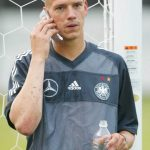 Christian Ziege: Former Germany Midfielder: Christian Ziege: Former Germany Midfielder on the phone with shaved mohawk