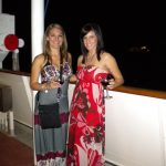 #TBT Bud Light Party Cruise : Deb and former 'Sorority Intern' Cassandra at the Bahamas Bud Light Party Cruise from 2009 with dressed in the night in front of a boat.