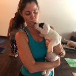 Puppy Yoga : A lady and a puppy at puppy yoga.