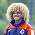 Carlos Valderrama: Former Colombia Midfielder: Carlos Valderrama: Former Colombia Midfielder smiling in the past with big blonde hair