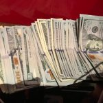 Jason's Vegas Vacation: a bunch of 100 dollar bills Jason won in Vegas