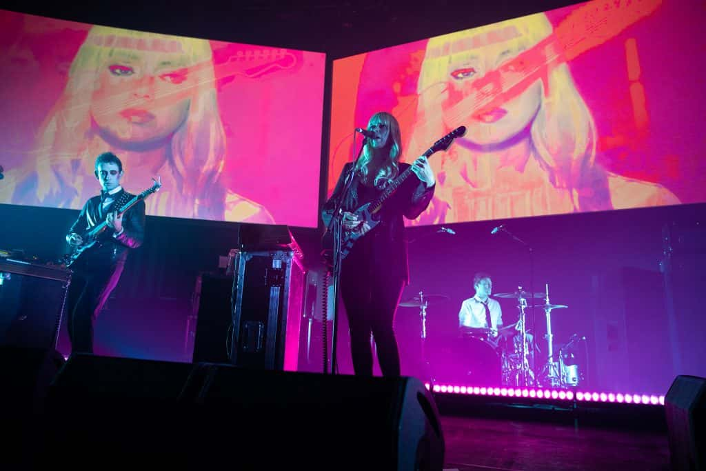 Adam Miller and Ruth Radelet of Chromatics perform on stage at The Roundhouse on October 27, 2019 in London, United Kingdom