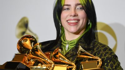 Billie Eilish poses in the press room with the awards for Album Of The Year, Record Of The Year, Best New Artist, Song Of The Y