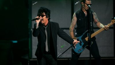 Billie Joe Armstrong, Jakob Armstrong, Joey Armstrong, Mike Dirnt, and Tre Cool of Green Day performs onstage during The Game A