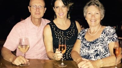 Deb drinking wine with her mum and father-in-law on her birthday