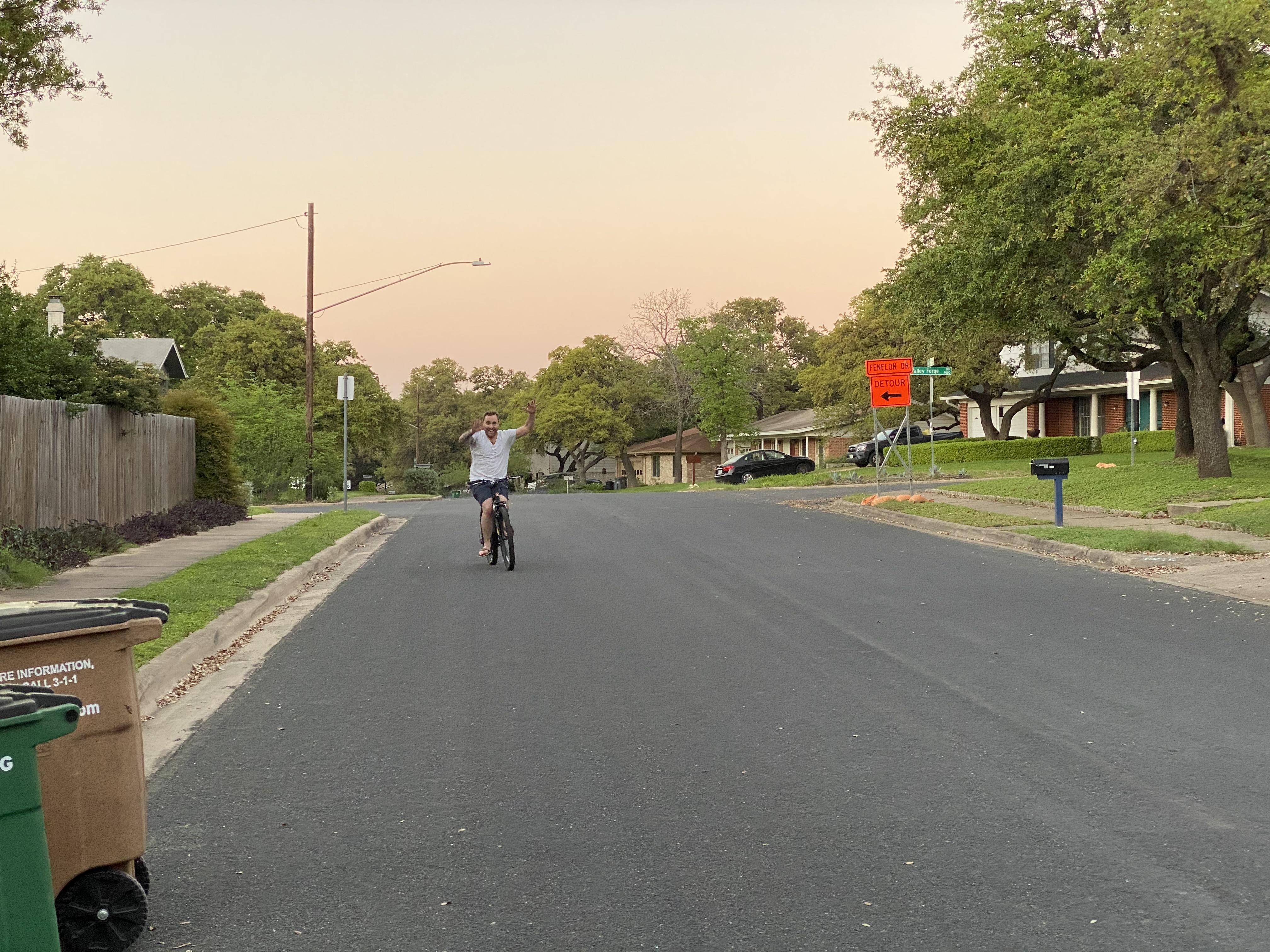 man riding bike no hands