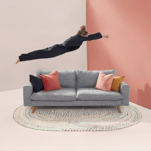 person jumping on a couch