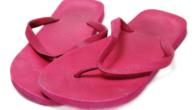 a stock image of a pair of pink chanclas